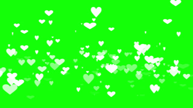 green background with moving heart shape - heart стоковые видео и кадры b-roll