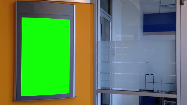 Green billboard for your ad on wall inside building video