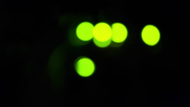 green bokeh led lights blinking on back side of working switch in server room - rack focus video stock e b–roll