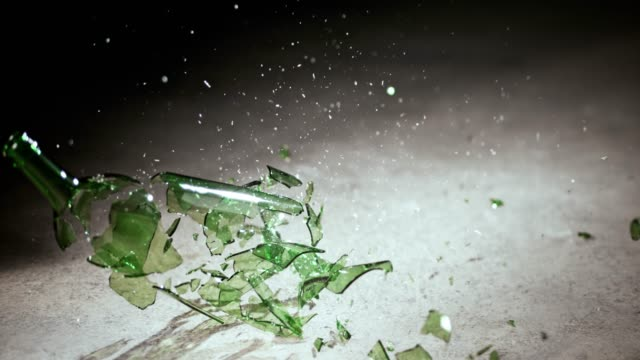 SLO MO LD Green bottle breaking when hitting the floor Slow motion wide locked down shot of a green bottle breaking into pieces as it hits the floor. Shot in Slovenia. bottle stock videos & royalty-free footage