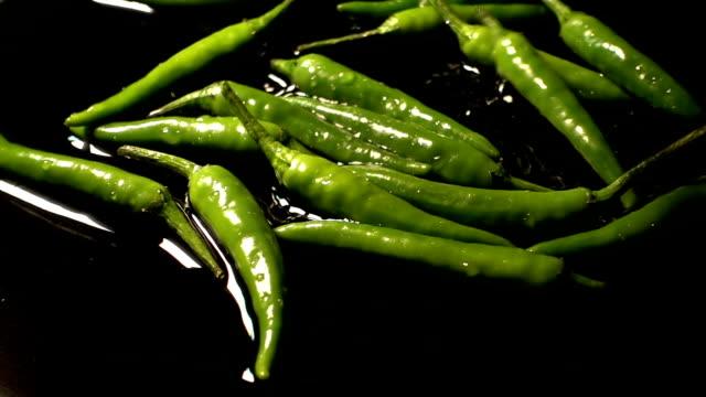 Green Chilies Falling And Splashing video