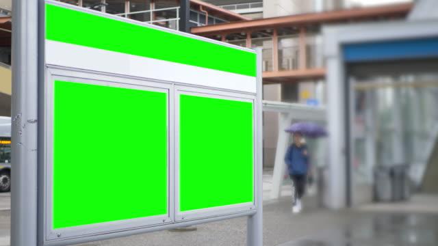 green chroma empty billboard advertisement panels at station - poster стоковые видео и кадры b-roll