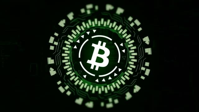 Green circular hologram rotating bitcoin sign in center video
