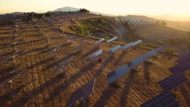 Green energy field on hills in Italy - Solar panels Green energy field on hills in Italy - Solar panels solar panels videos stock videos & royalty-free footage