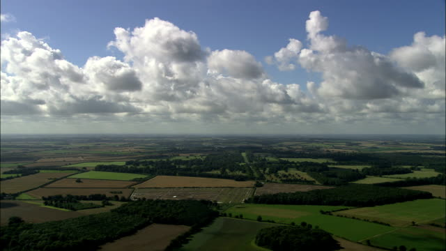 Green English Landscape under Blue Sky - Aerial View - England, Norfolk, King's Lynn and West Norfolk District, United Kingdom video