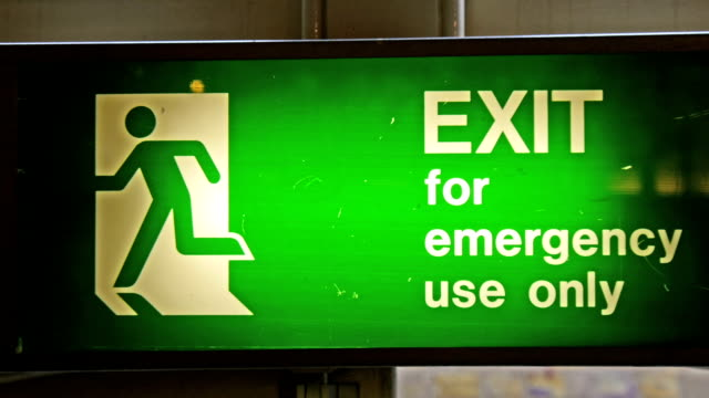 A green Exit sign for emergency use only video