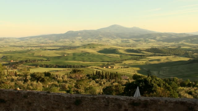 Green field in Tuscan Val d'Orcia  landscape at sunset video