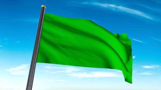 vídeos de stock, filmes e b-roll de verde bandeira acenando. luma matte fornecido assim que você pode colocar seu próprio fundo. - flag