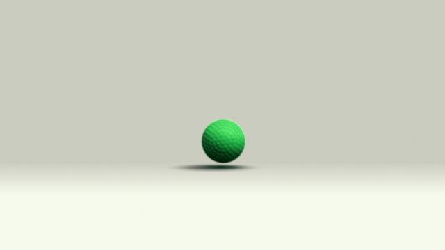 Green golf ball rolling