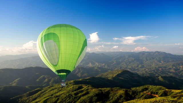 Green Hot air balloon fly over mountain video