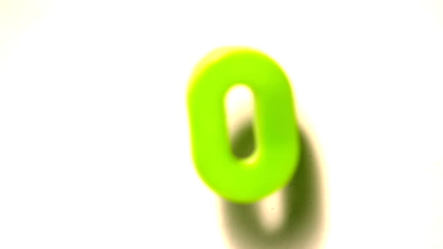 Green number zero lifting off white background video