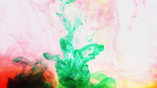 green paint is poured into a multicolored mixture ink paint in water, relax background