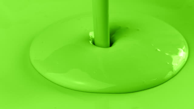 green paint pouring on green surface - соус стоковые видео и кадры b-roll