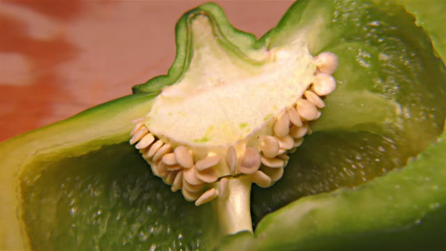 vídeos de stock e filmes b-roll de green paprika – close up, detail, macro - red bell pepper isolated