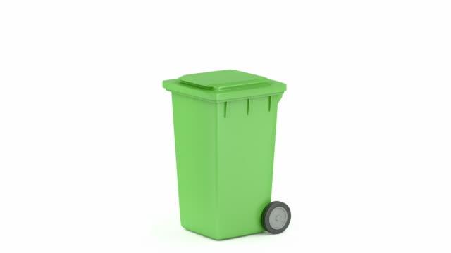 green plastic waste container - coperchio video stock e b–roll