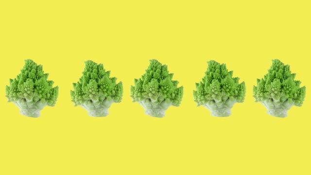 green ripe romanesco broccoli animated on a yellow background close-up