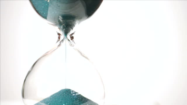 Green Sand Falls White Background Time Passes Hourglass video