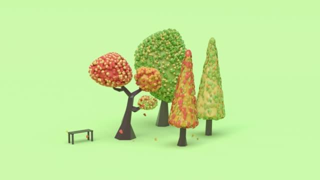 緑のシーン秋カラフルな木漫画スタイルの3d レンダリング抽象的なモーションリーフドロップ/落下 - ローポリモデリング点の映像素材/bロール