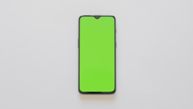 Green Screen - A modern smartphone lies on white background