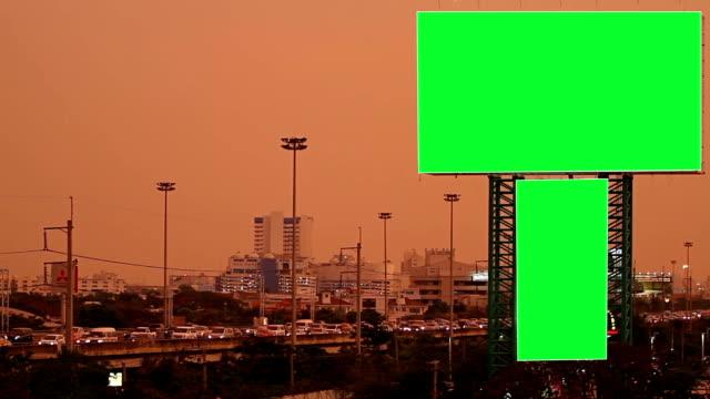 Green screen billboard with traffic at night video