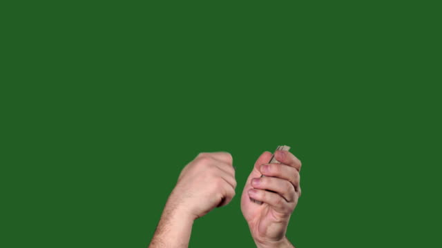 Green screen. Chromakey. Man's hands interfere with a deck of cards and throw them.