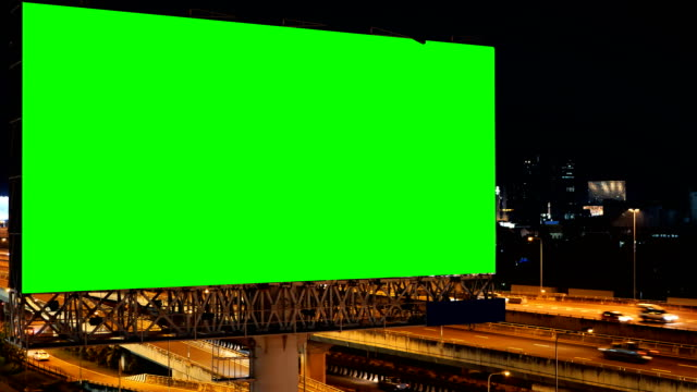 green screen of advertising billboard on expressway during the twilight with city background in bangkok, thailand. - road signs stock videos and b-roll footage