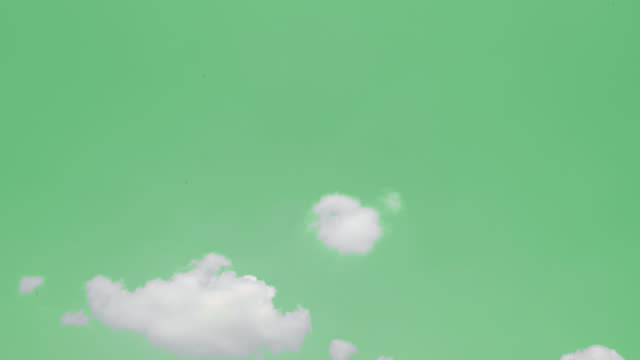 Green screen of moving white clouds with 4K resolution.