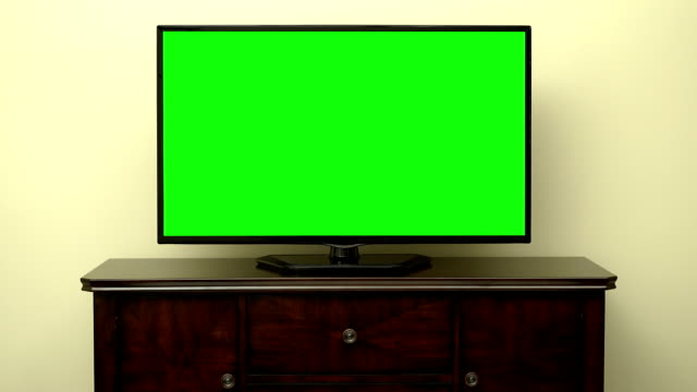 TV Green Screen Pan A television in a living room with a green screen. The Shot is a slow 5 second pan into the television set with nobody in the image and just a empty room. living room stock videos & royalty-free footage