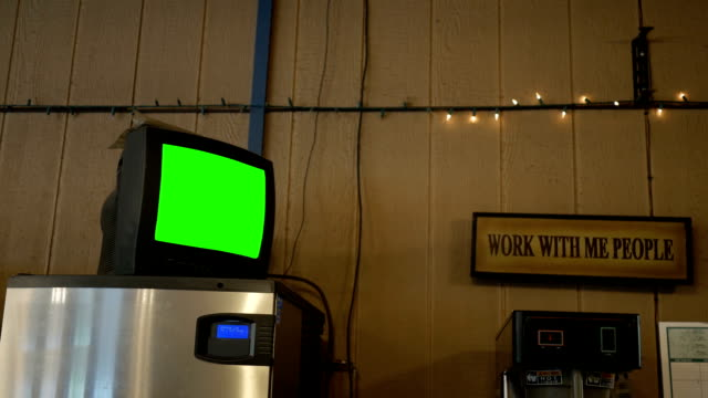 A green screen standard definition TV in a diner for generic use video