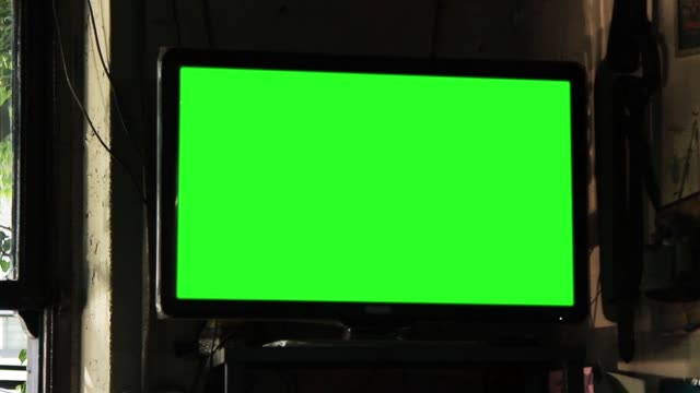 green screen television in a bar. - bar video stock e b–roll