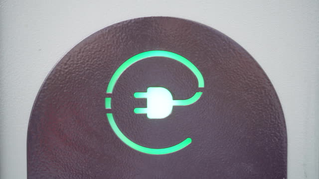 Green sign of power socket for electric cars. Concept of eco friendly resources preservation video