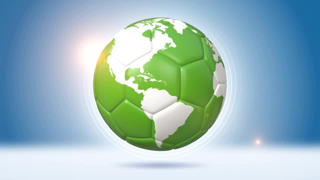 vídeos de stock, filmes e b-roll de bola de futebol em formato de globo verde - futebol internacional
