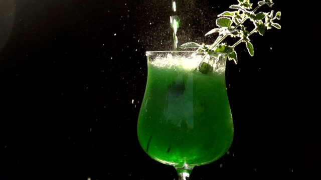 Green Soda Being Poured into a Glass video