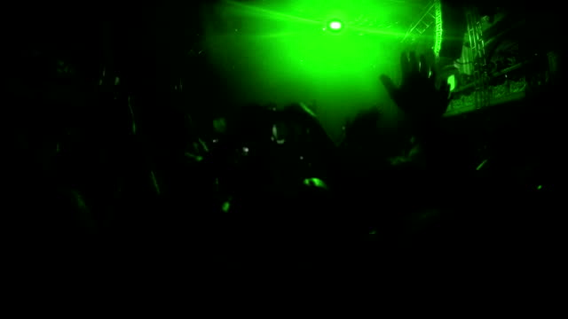 Green spotlights flashing during the rock-concert video