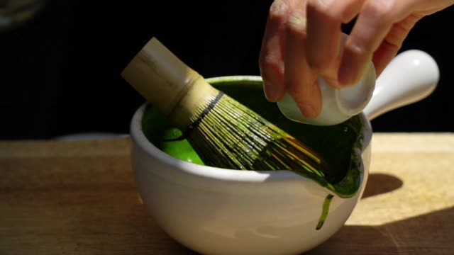 Green Tea Matcha with traditional bamboo whisk.