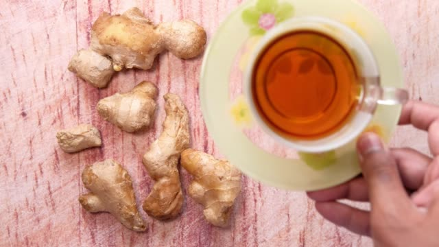 green tea with ginger on table, top view - disintossicazione video stock e b–roll