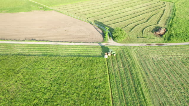 Green Tractor Hay Cutter Aerial View