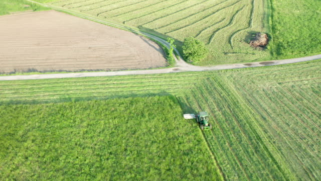 Green Tractor Hay Cutter Aerial View - video