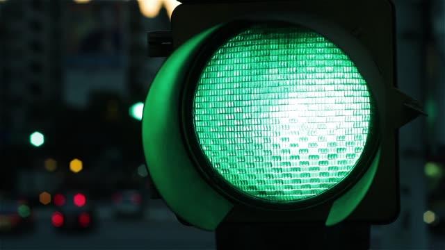 Green Traffic Light Signal At Night. Close-Up. Green Traffic Light Signal At Night. Close-Up. Full HD. stoplight stock videos & royalty-free footage