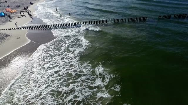 green uchrine sea with breakwater video
