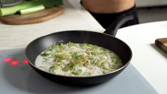 green vegetables roasted with coconut milk in pan. thai dish - crucifere brassicali video stock e b–roll