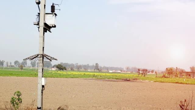 Green wheat field, view from running passenger train HD Video : - Green wheat crop view from running express passenger train. haryana stock videos & royalty-free footage