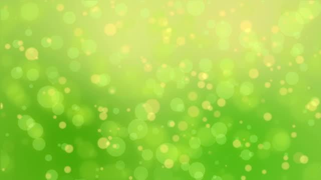 Green yellow bokeh lights background video