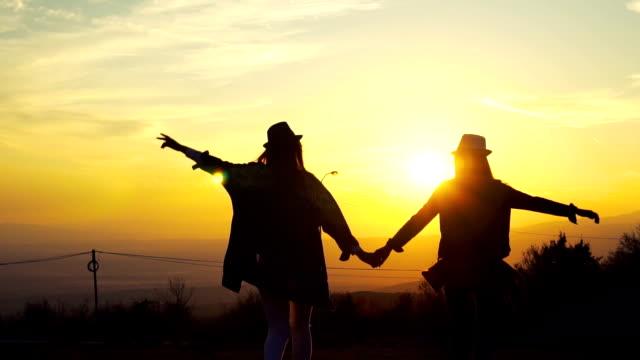 greeting the autumn sun - coppia gay video stock e b–roll