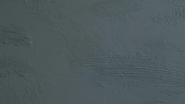 灰色のコンクリート壁のテクスチャです。 - セメント点の映像素材/bロール