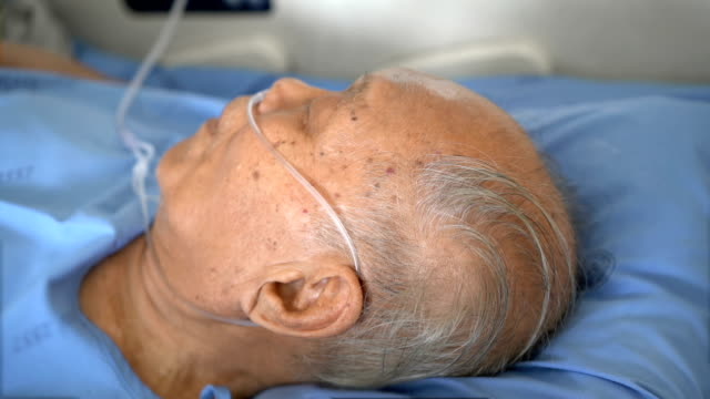 Grey hair senior male patient sleeping in hospital Grey hair senior Asian male patient sleeping in hospital medical oxygen equipment stock videos & royalty-free footage