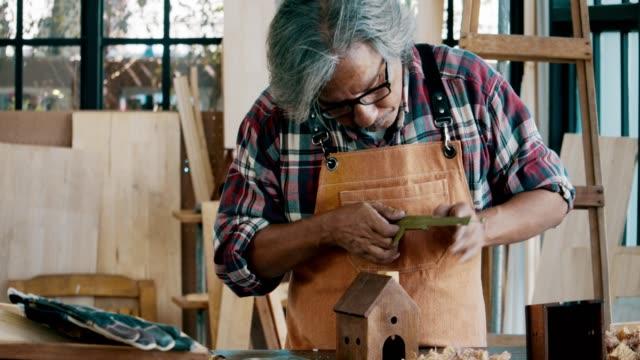Grey Power : Asian senior carpenter
