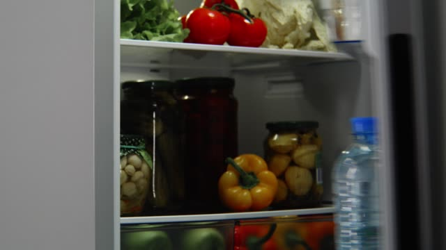 grey refrigerator full of food with opening and closing door modern grey domestic refrigerator full of different tasty food with opening and closing door closeup fridge stock videos & royalty-free footage