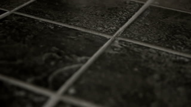 Grey Tiles Close up dolly of grey tiles. tile stock videos & royalty-free footage