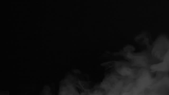 Grey white steam on black background HD 1080 Emission of white smoke on a black background HD 1920x1080 heat haze stock videos & royalty-free footage